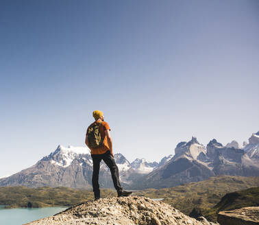 Hiker in mountainscape at Lago Pehoe in Torres del Paine National Park, Patagonia, Chile - UUF20234
