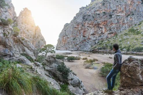 Man enjoying nature lookng to the sea, Mallorca, Spain - DIGF10359