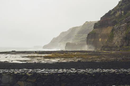 Scenic view of cliffs at Ponta da Ferraria against clear sky - FVSF00230