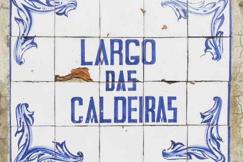Close-up of Largo das Caldeiras text on tiled wall, San Miguel, Azores, Portugal - FVSF00248