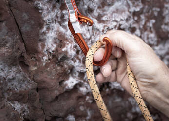 Clipping a climbing rope into a karabiner - ALRF01752