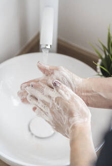 Close-up of woman washing her hand with soap - SNF00027