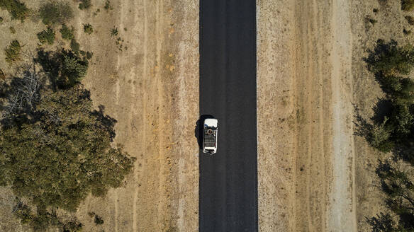 Namibia, Aerial view of 4x4 car driving alongNational Road B15 - VEGF02126