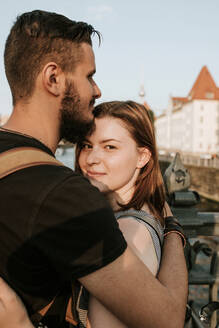 Portrait of affectionate young couple embracing in the city, Berlin, Germany - VBF00007