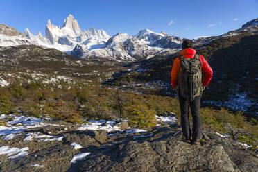 Hiker in front of Mount Fitz Roy in Autumn, El Chalten, Patagonia, Argentina - LOMF01087
