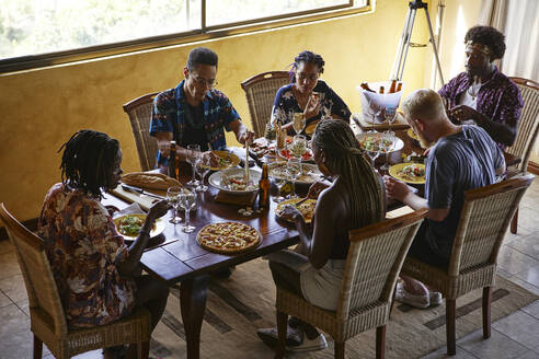 High angle view of friends enjoying lunch while sitting at dining table - VEGF02208