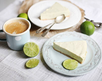 Lime cheesecake slices on plates and coffee - VBF00045