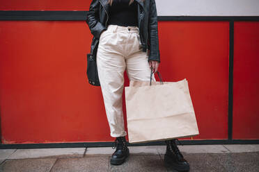 Crop view of woman with shopping bags in the city - GRCF00230