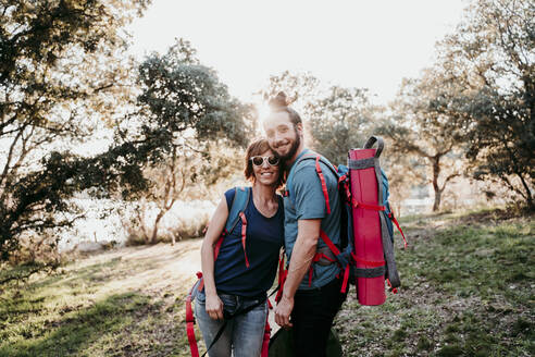 Happy couple with backpacks on a hiking trip - EBBF00029