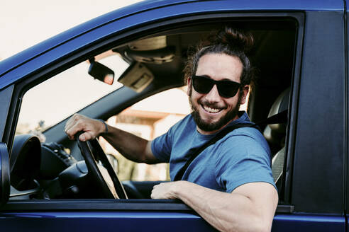 Portrait of happy man in car - EBBF00068