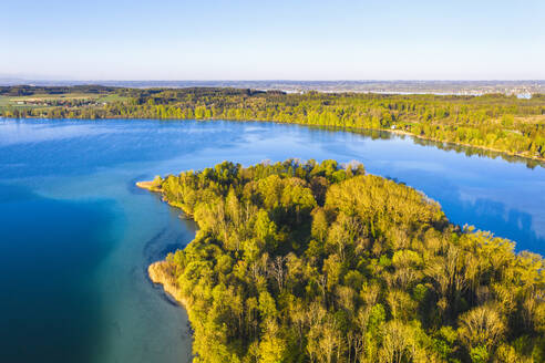 Germany, Bavaria, Inning am Ammersee, Drone view of clear sky over forested shore of Worth island - SIEF09841