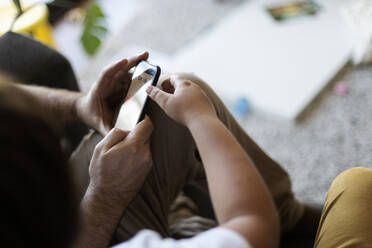 Crop view of father and son using smartphone - VABF02942