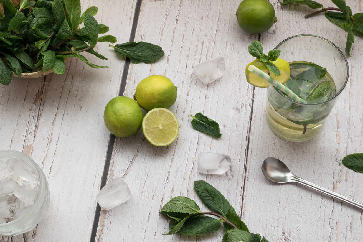 Top View Of A Mojito Cocktail And Its Ingredients On A White Rus Cavf80841 Cavan Images