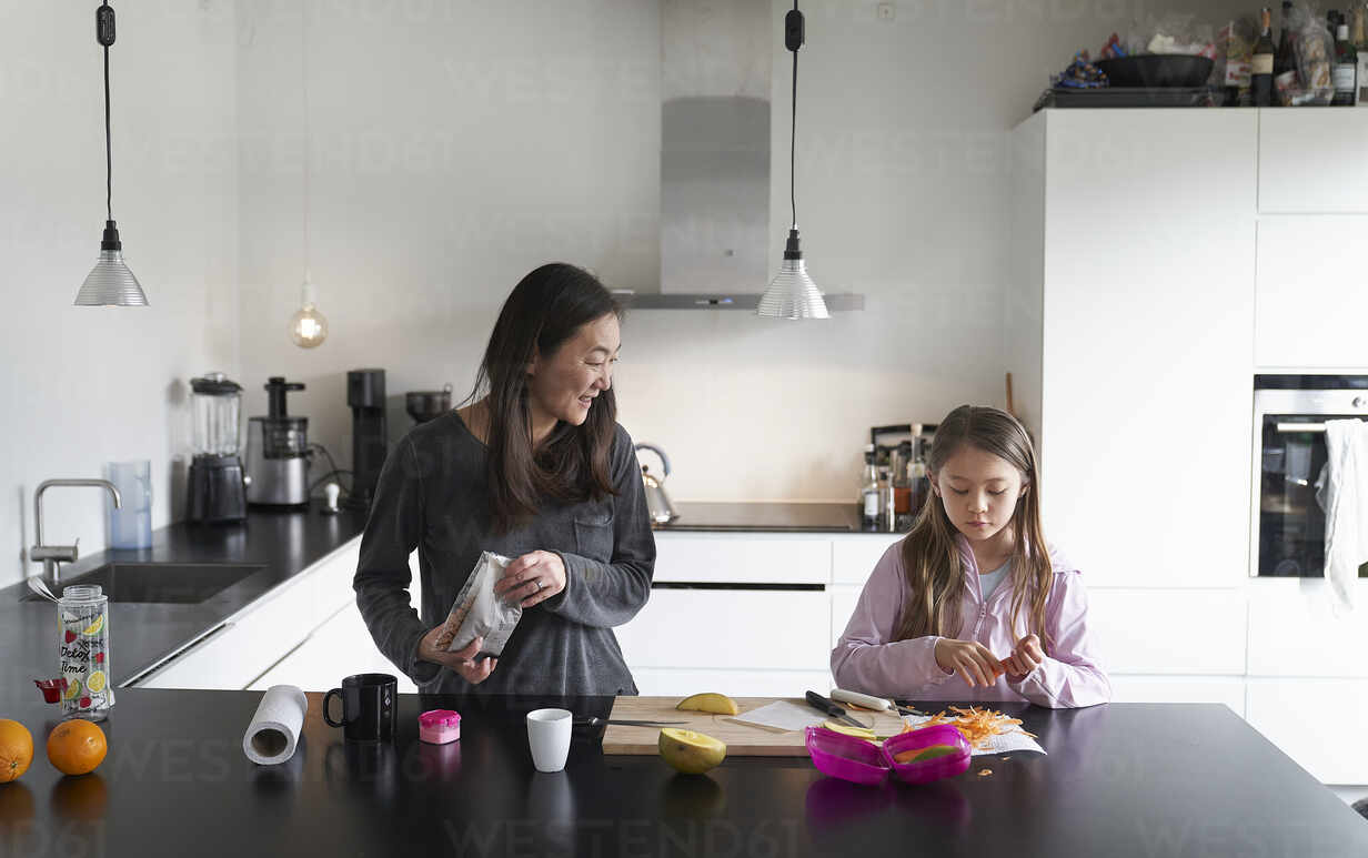 Home Life A School Morning During Lockdown A Girl And Her Mother In A Kitchen Cooking