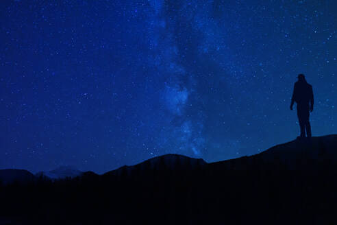 Star Gazing At Night Silhouette In Mountains - CAVF81199
