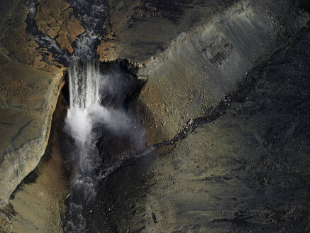Aerial shot of unnamed waterfall in the highlands of Iceland - CAVF81259