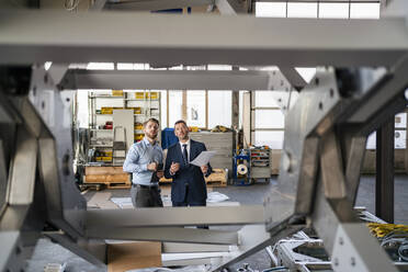 Two businessmen having a meeting in a factory - DIGF11081