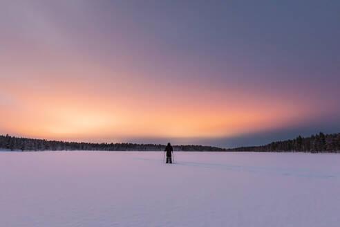 Snowshoe hiker in winter landscape, Hetta, Enontekioe, Finland - WVF01559