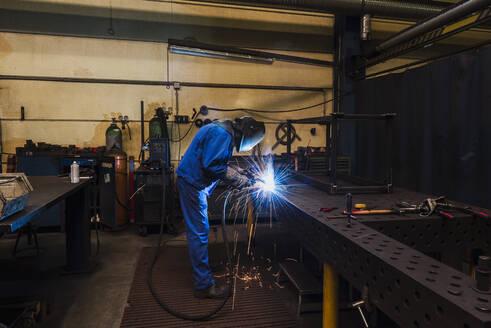 Welder welding metal in a factory - DIGF11357