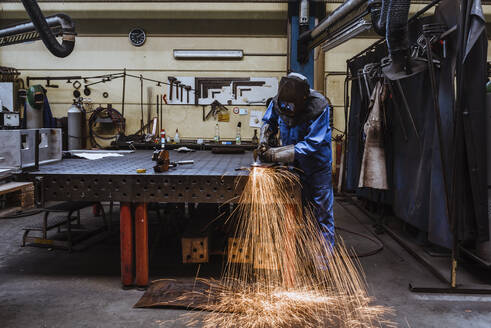 Welder welding metal in a factory - DIGF11360