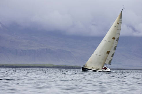 Sailboat tipping in wind in Iceland - CAVF82156