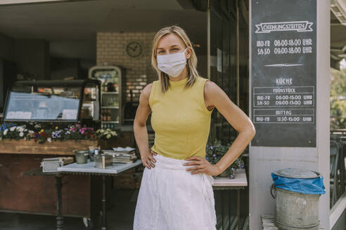 Portrait of confident cafe owner wearing face mask - MFF05675