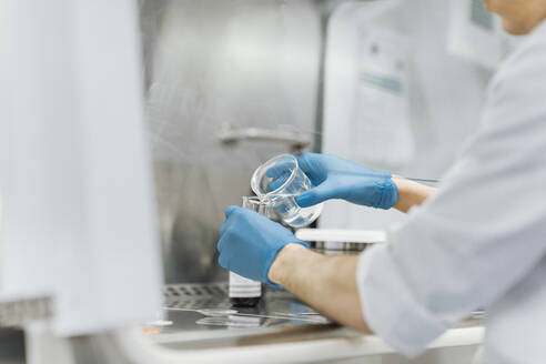 hands of Scientist working at laboratory - OCAF00516
