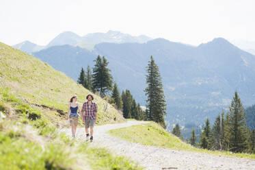 Hiking couple on hiking trail in summer, Wallberg, Bavaria, Germany - DIGF11665