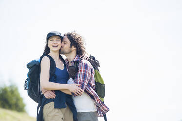 Hiking couple on meadow in summer, Wallberg, Bavaria, Germany - DIGF11674