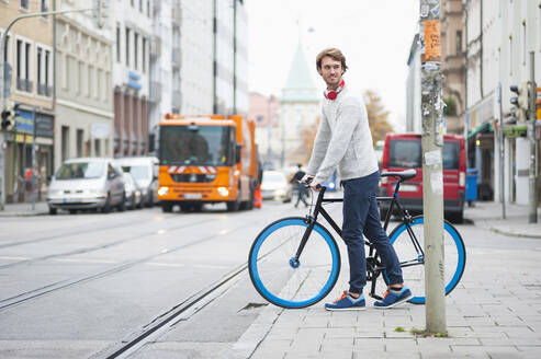Portrait of young man with bicycle in the city - DIGF12304
