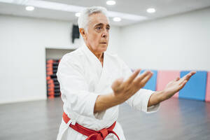 Senior Karate master performing combat techniques - CAVF83362