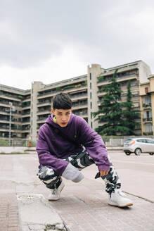 Man posing on street against buildings in city - MEUF00592