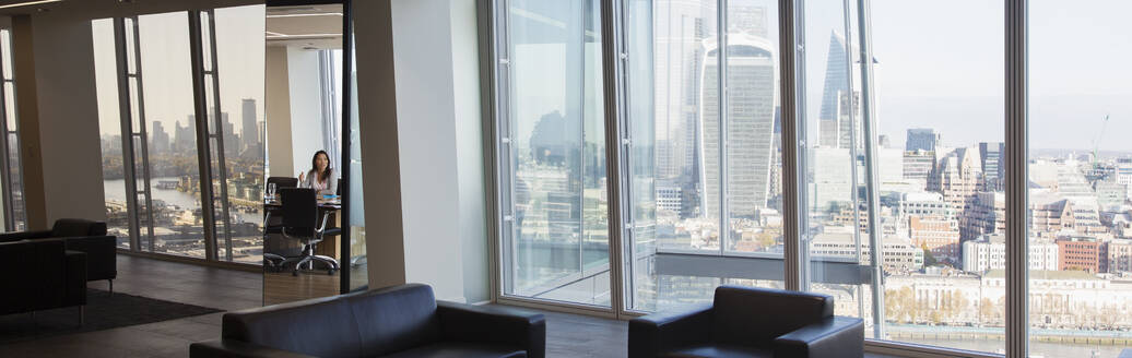 Businesswoman in modern urban highrise conference room - CAIF27600
