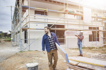 Construction workers working at construction site - MJFKF00308