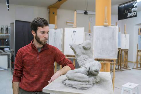 Student standing next to his sculpture - FBAF01580