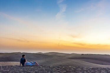Couple at sunset in the dunes, Gran Canaria, Spain - DIGF12559