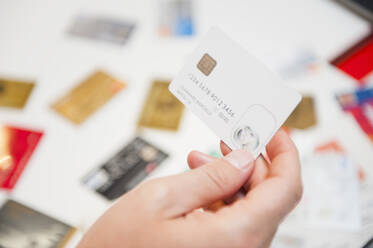 Hand of man holding blank white credit card - DIGF12667