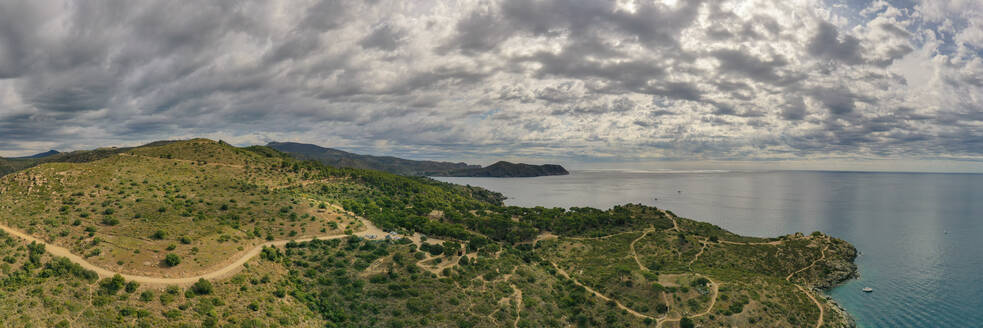 Panoramic aerial view of the shore of the bay on cloudy day in Roses, Spain - AAEF08739