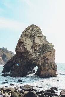 Scenic view of rock formation in sea against sky at Ursa beach, Portugal - FVSF00445