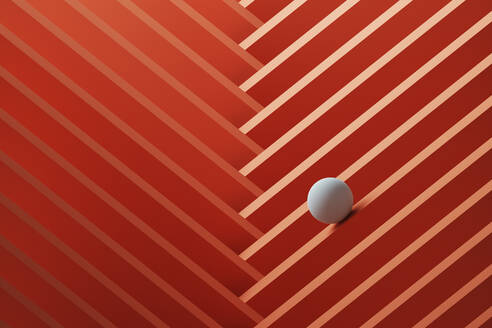 Three dimensional render of small white sphere rolling over geometric pattern - DRBF00169
