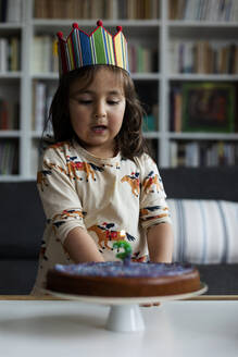 Portrait of little girl celebrating birthday at home - VABF03024