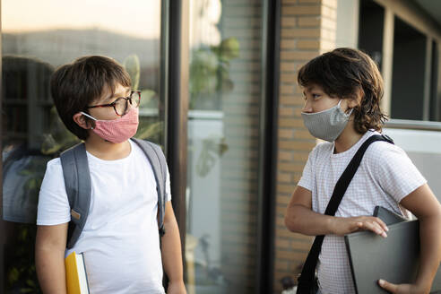 Siblings wearing masks outdoors - VABF03061