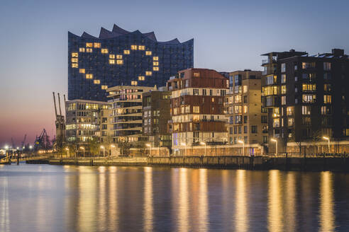 Germany, Hamburg, Heart shape displayed on Elbphilharmonie at dusk - KEBF01537