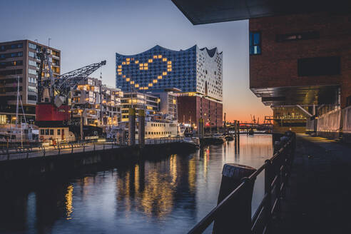 Germany, Hamburg, Heart shape displayed on Elbphilharmonie at dusk - KEBF01540