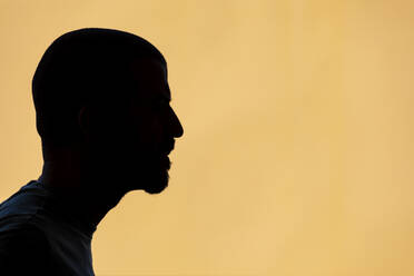 Silhouette of man against yellow background - WPEF03023