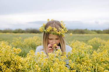Portrait of girl with wreath of rape flowers - EYAF01135