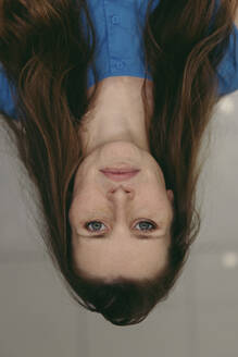 Upside down image of mid adult woman - MFF05886