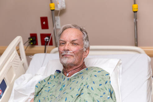 Portrait Of Senior Patient On Bed In Hospital - EYF05503