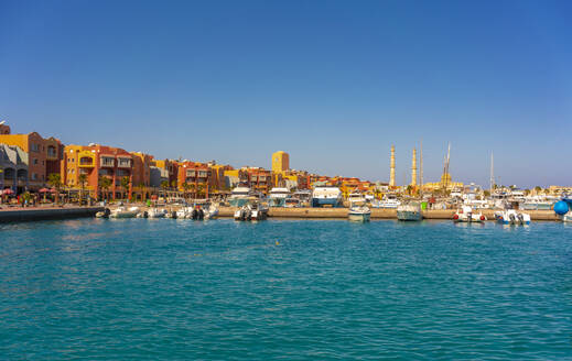 Egypt, Red Sea Governorate, Hurghada, Boats moored in harbor of seaside city - TAMF02288