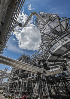 Natural gas processing plant structures with blue sky - CAVF85435